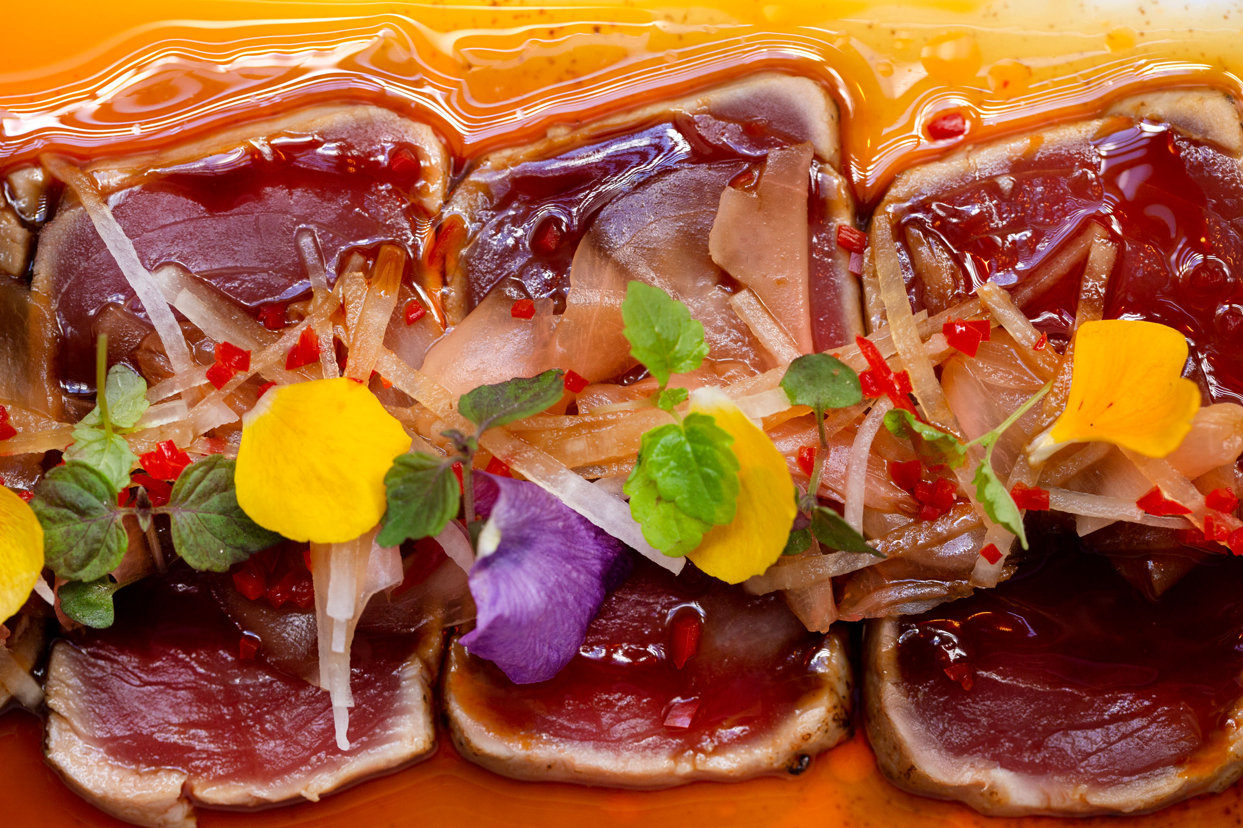 Tuna tataki with yuzu ponzu dressing, pickled ginger, daikon and shiso  - C48A7444